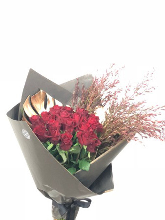 Heart of Gold - A imaculate display of stunning long stem red roses presented with gold leaf accents and luxe wrapping, This is sure to Impress!!